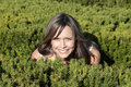 Pretty mother crouching in bushes Stock Photo