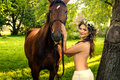 Pretty nude woman with horse Royalty Free Stock Photo