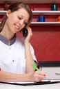 Pretty nurse on phone  recorded data Stock Photo
