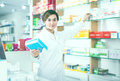 Pretty pharmacist offering reliable medicine Royalty Free Stock Photo