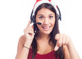 Pretty phone operator in Santa hat over white Royalty Free Stock Photo