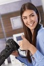 Pretty photographer giving thumb up Royalty Free Stock Photography