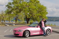 Pretty pink car and matching driver
