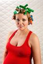 Pretty pregnant woman with hair rollers Royalty Free Stock Image