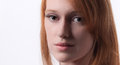 Pretty redhead a close up portrait of a gorgeous young woman with red hair Royalty Free Stock Images