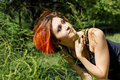 Pretty redhead girl in nature Stock Images
