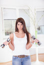 Pretty sad girl exercise with weights Royalty Free Stock Photo