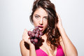 Pretty sexy brunette girl eating grapes wearing bikini young isolated on the white background Stock Photos