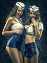 Pretty sexy vintage sailors - womens on dark Royalty Free Stock Photo