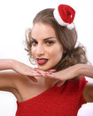 Pretty sexy woman in santas red hat isolated brunette Royalty Free Stock Photography