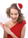 Pretty sexy woman in santas red hat isolated brunette Royalty Free Stock Image