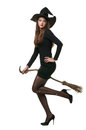 Pretty sexy young brunette witch with a broom Stock Photos