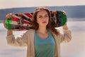 Pretty skater girl holding skateboard Royalty Free Stock Photo
