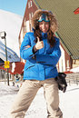 Pretty skier showing thumbs up Royalty Free Stock Photos