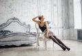 Pretty slim brunette woman resting in luxury room