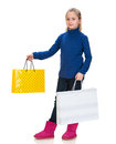Pretty small girl with shopping bags over white Stock Photo