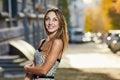 Pretty smile woman sunlight city portrait Royalty Free Stock Photo
