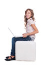 Pretty smiley schoolgirl with laptop Royalty Free Stock Images