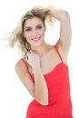Pretty smiling blonde model looking at camera Royalty Free Stock Photo