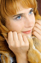 Pretty smiling blue-eyed foxy woman Stock Photography
