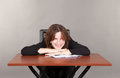 Pretty smiling business woman sitting at the table Royalty Free Stock Photo