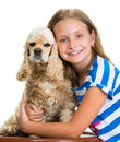 Pretty smiling girl with american spaniel Royalty Free Stock Photo