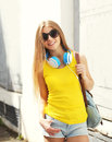 Pretty smiling girl with headphones and backpack Royalty Free Stock Photo