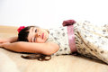 Pretty smiling girl lying on the floor at home. Royalty Free Stock Photo