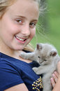 Pretty smiling happy girl with new pet kitten a joyful portrait in color of a lovely young holding her addition to her family her Stock Photos