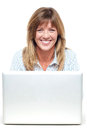 Pretty smiling lady working on laptop Royalty Free Stock Images