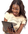 Pretty smiling woman holding digital tablet Royalty Free Stock Images
