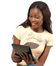 Pretty smiling woman holding digital tablet african american using against white background Royalty Free Stock Photos