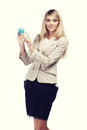 Pretty smiling woman holding a world globe and dreaming about traveling business woman Royalty Free Stock Photography