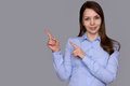 Pretty smiling woman pointing finger Royalty Free Stock Photo