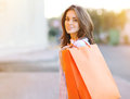 Pretty smiling woman with shopping bags lifestyle casual portrait Royalty Free Stock Photography