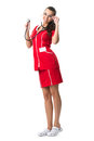 Pretty spectacled women doctor with stetoscope in red dress woman Stock Photo