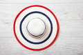 Pretty straw hat with ribbon and bow on white background. Beach hat top view isolated Royalty Free Stock Photo