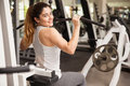 Pretty strong brunette working out in a gym Royalty Free Stock Photo