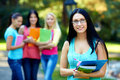Pretty student with group of people on background Royalty Free Stock Images