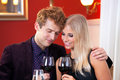 Pretty sweet lovers holding glass of wines close up young with guy hand on partners shoulder Royalty Free Stock Photography