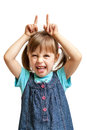 Pretty sweet young girl doing evil devil isolated Royalty Free Stock Photo