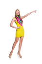 Pretty tall woman in short yellow dress isolated