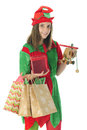 Pretty Teen Elf Carrying Gifts Royalty Free Stock Photo