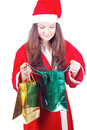 Pretty teen girl dressed as Santa looks gifts Royalty Free Stock Photo