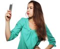 Pretty teen girl taking selfies Royalty Free Stock Photo