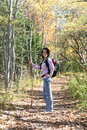 Pretty teen hiking outside in the fall Stock Image