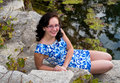 Pretty teen on rocks teenage girl sitting by a lake Stock Photos