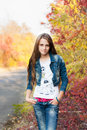 Pretty teenage girl in the autunm park Stock Photography