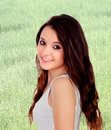 Pretty teenage girl with big eyes and a nice background wheat meadow Royalty Free Stock Images