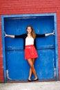 Pretty Teenage Girl Blue Door